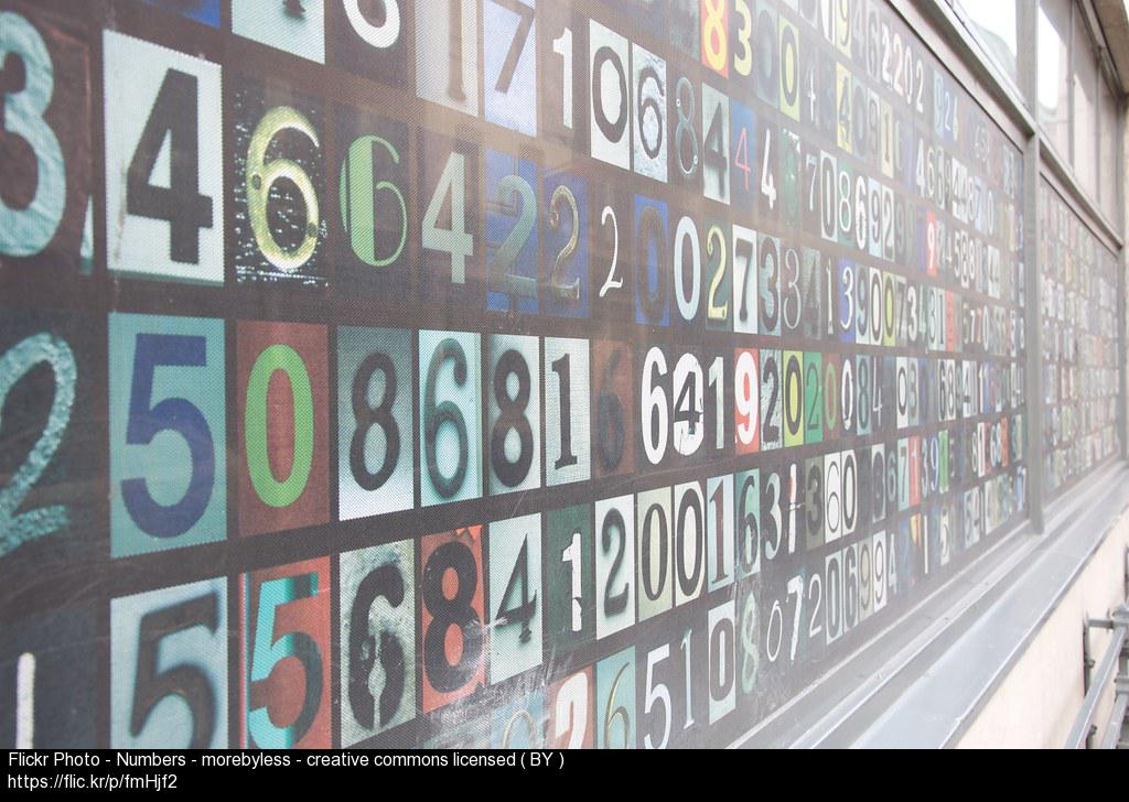 A bank of numbers on a wall to illustrate statistics